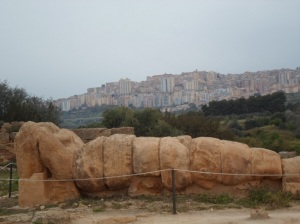 Stone meets cement-greek statue with Agrigento in the background